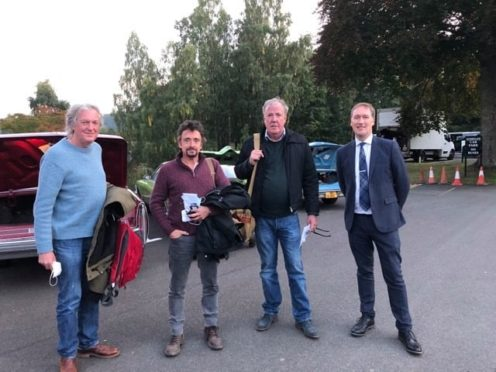 James May, Richard Hammond and Jeremy Clarkson with the general manager of the Atholl Palace Hotel, Graeme Strachan.