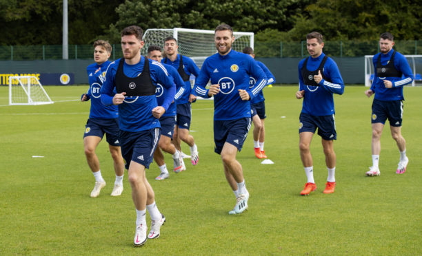 Captain Andy Robertson leads the Scotland squad in training.