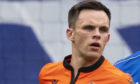 Lawrence Shankland is marked closely by Connor Goldson at Ibrox.