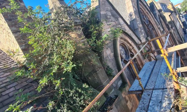 Work is under way to clear shrubbery and vegetation from St Andrew's and St Stephen's Church in Perth.