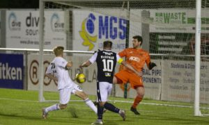 Dundee's Paul McGowan heads the winner against Cove Rangers.