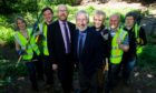 Silverburn volunteers Kate Appleyard, Jordan Ford, Ron Daniel, Jack Robertson, Duncan Mitchell and David Williams with Keith Wimbles of Voluntary Action Fund (third left).