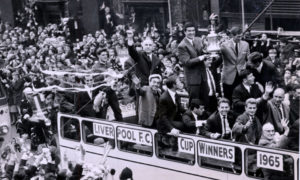 Big Ron Yeats holds aloft the 1965 FA Cup on the victory bus, flanked by Bill Shankly.