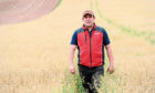 Pictured is Iain Wilson in one of the fields previously grazed by sheep at Upper Coullie Farm, Fourdon, Laurencekirk. Picture by DARRELL BENNS   Pictured on 10/09/2020 CR0023734