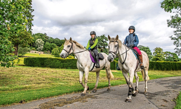 Instructor Kirstin McGregor and Gayle Ritchie pass through the grounds of Hill of Tarvit during their hack around north-east Fife.
