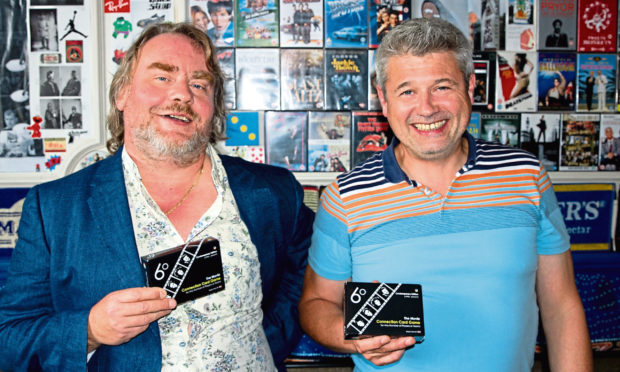 John Bannerman and Andrew Allen of TKC Games holding their card game, 6 degrees of separation.