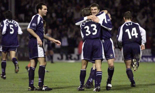 Dundee goalscorers Georgi Nemsadze and Claudio Caniggia embrace after a crucial second goal killed off their neighbours.