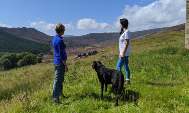 Katy Fennema of Braemar Highland Experience with Gayle Ritchie and her dog Toby in Glen Fearder.