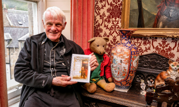 Retired detective and Violin Shop owner Bob Beveridge with copies of his new book 'An Extraordinary Autobiography'