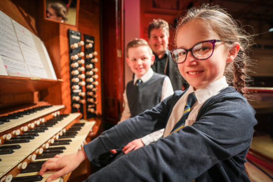 Concert organist Dan Moult in February with gifted young pianist Elizabeth Levins (9) and Euan Thomson (10) both from St Joseph's at the Caird Hall organ in early 2020.