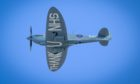 "The ""Thank You NHS"" Spitfire flies over the Royal Infirmary of Edinburgh."
