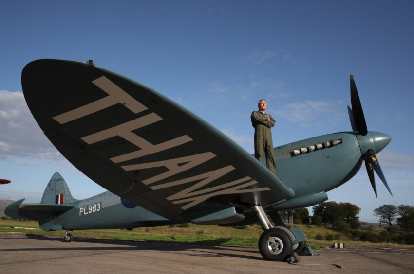 """Pilot John Romain with the """"Thank You NHS"""" Spitfire at Cumbernauld Airport as he carries out final preparations ahead of flying over Scottish hospitals to raise money for NHS Charities Together."""