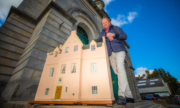 Auctioneer Nick Burns with the scaled down fortress