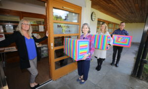Rainbow Boxes being delivered to Menzieshill House. Ashley Grays, (left) senior social care officer at Menzieshill House, receiving the boxes from Lorna Donnelly, Emma Jane Wells and Richard McIntosh of the Tayside Health Fund.