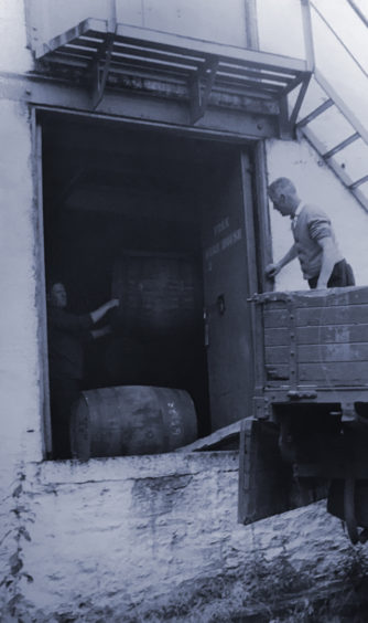 Workers transporting casks.