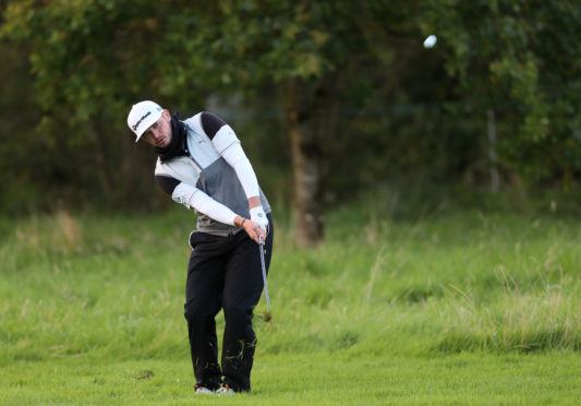 Scotland's Ewen Ferguson ground away under his snood in the cold at the Irish Open.