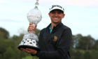 USA's John Catlin celebrates with the trophy after winning The Irish Open.
