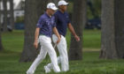 Justin Thomasand Tiger Woodsat the seventh green during the first round of the US Open.
