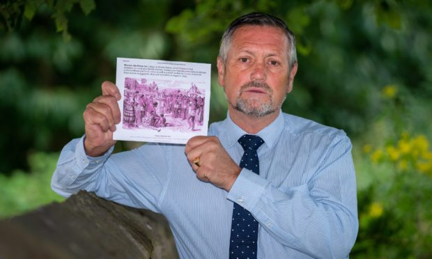 Mr Haldane with a copy of the Abolition of Slavery Act.