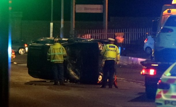 One of the cars being removed from the crash on Abroath Road.