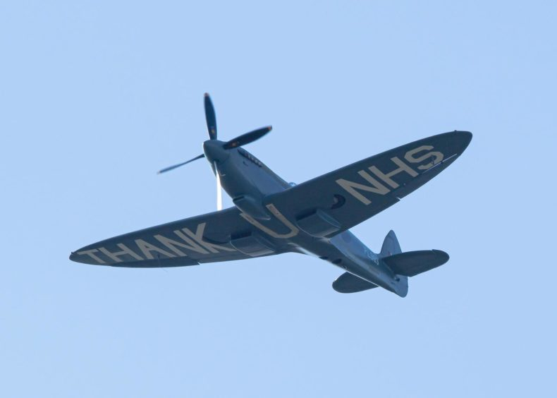 The NHS Spitfire passing over Queen Margaret Hospital in Dunfermline by Jock Elliot.
