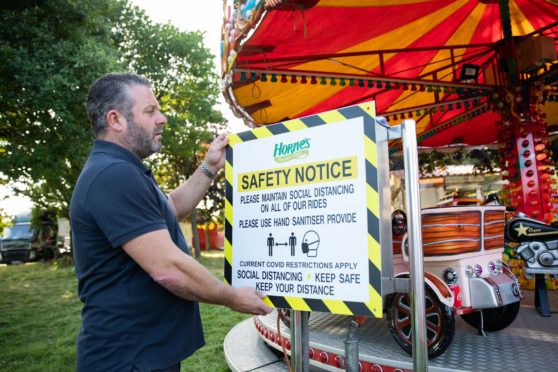Christian Horne checks the new safety advice notices