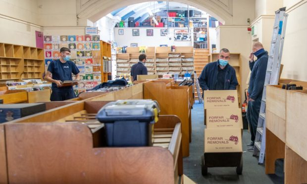Staff from Forfar Removals take on the job of emptying Groucho's Music Store.