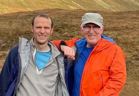 New Minister Tim Mineard and Church of Scotland Moderator the Rev. Dr Martin Fair during one of their hillwalking outings.