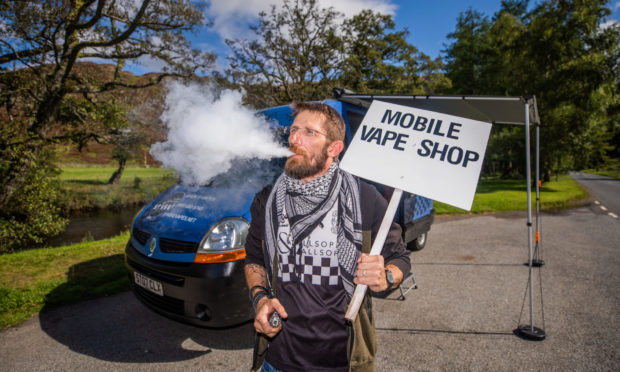 Demis Cunningham with his Scotland's first Mobile Vape Shop.