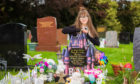 Natasha-Lee McGilligan by Roxie's graveside.