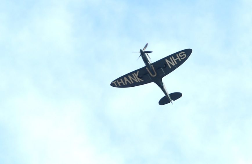 The Spitfire flies over Raigmore Hospital in Inverness.