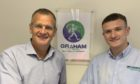 Ross Graham (left) welcomes son Jamie to the Graham Pest Control business graduate trainee programme