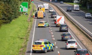 Police and ambulance in attendance on the A9 in Perth on Monday afternoon.