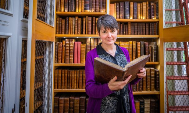 Keeper of the Books Lara Haggerty in the Library of Innerpeffray Library. Photo: Steve MacDougall / DCT Media