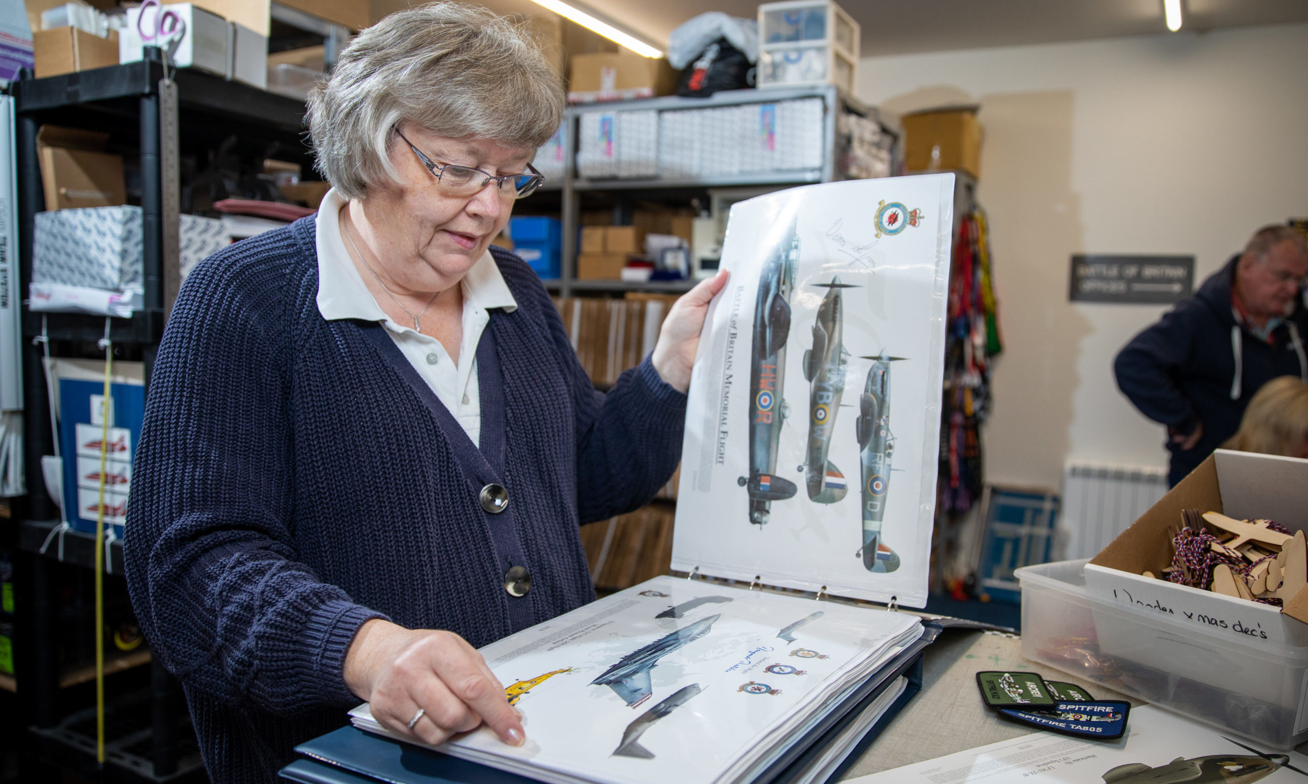 Gill Howie with her master collection of signed prints including one commemorating the Battle of Britain Memorial flight which is signed by Vera Lynn.