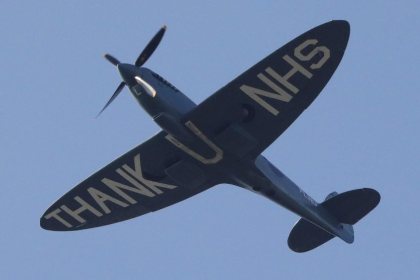The NHS Spitfire passes over Ninewells Hospital in Dundee.