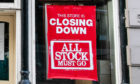A closing down sign at Dundee's Edinburgh Woollen Mill shop