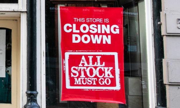 A closing down sign at Dundee's Edinburgh Woollen Mill shop
