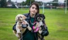 Hayley Burt with her dogs Macy and Lola, who were attacked by a Jack Russell Terrier dog in Rosyth Public Park.
