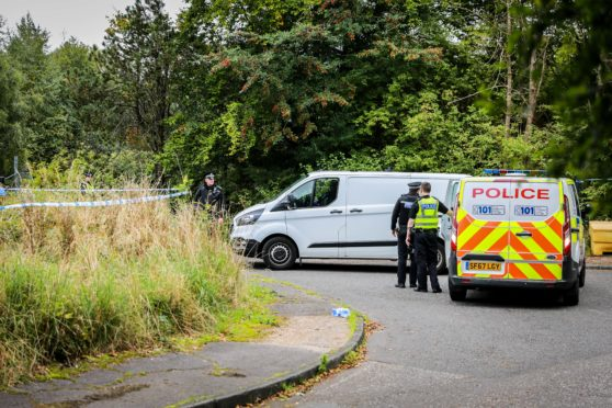 Police investigators and forensics experts spen over a week at Whitehill Road in Glenrothes where the human remains were found.