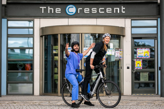 Medical Student Fareed Nadeem and Dr BEcky Forrester with the new eBikes used for patient visits. Whitfield Surgery, based at The Crescent in Dundee has become Scotland's first GP surgery to use eBikes to carry out house visits
