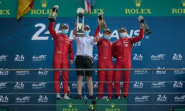 Jonny Adam (left) and the victorious TF sport team on the Le Mans 24 Hours podium