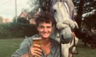 Louis enjoys a well earned pint of beer during his epic 1,147-mile journey.