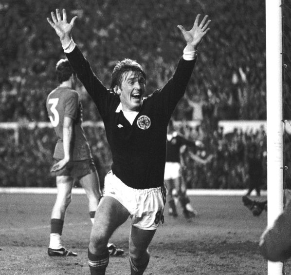 Kenny Dalglish celebrates Scotland's second goal, beating Wales in 1977 to qualify for the World Cup finals in Argentina.