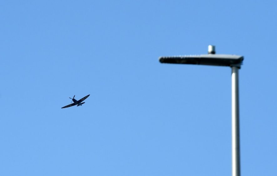 The Spitfire flying over Aberdeen Royal Infirmary.