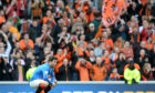 A dejected Richard Foster in front of elated Dundee United fans the last time United played Rangers at Ibrox.
