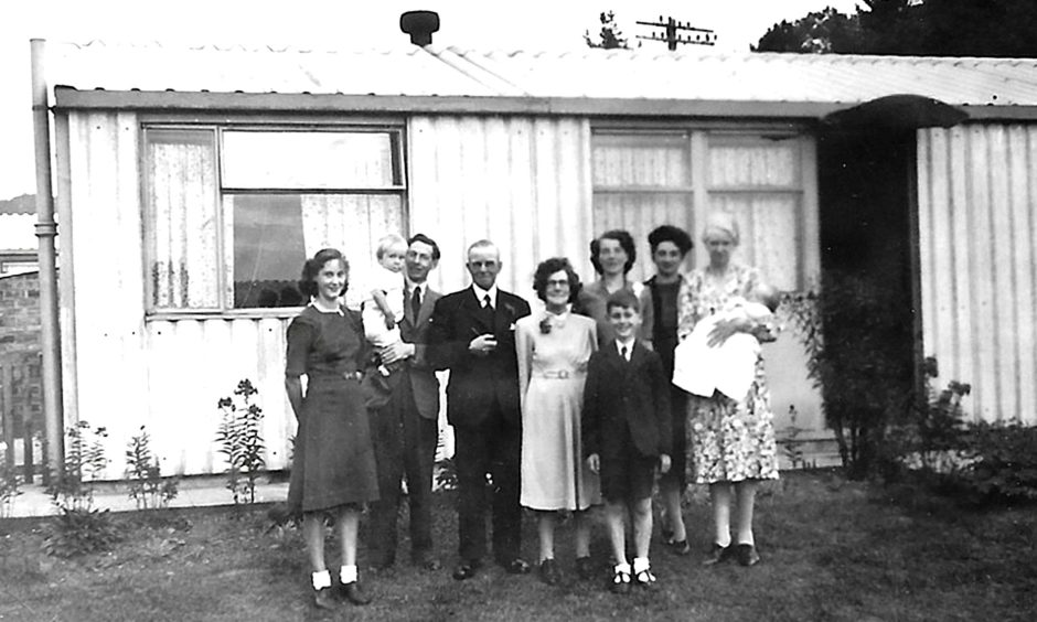 Jim Crumley's family in the front garden at 97 Glamis Road following his christening.