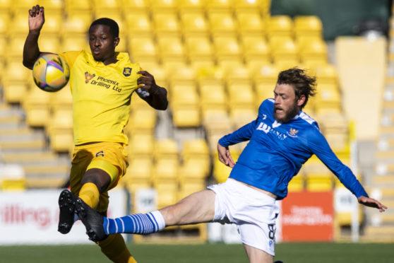 Murray Davidson makes a tackle.