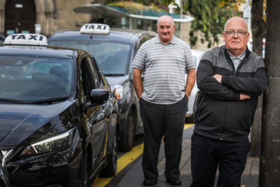 Taxi drivers Ronnie Cargill and Chris Elder at the Meadowside taxi rank.