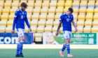 A dejected Murray Davidson and Callum Hendry at full-time at Livingston.